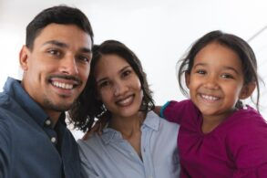 latino-couple-and-daughter-taking-selfie-smiling-to-camera-picture